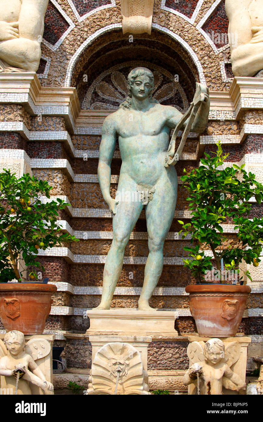 Statue of Appolo. The Organ fountain, 1566, housing organ pipies driven by air from the fountains. Villa d'Este, - Stock Image