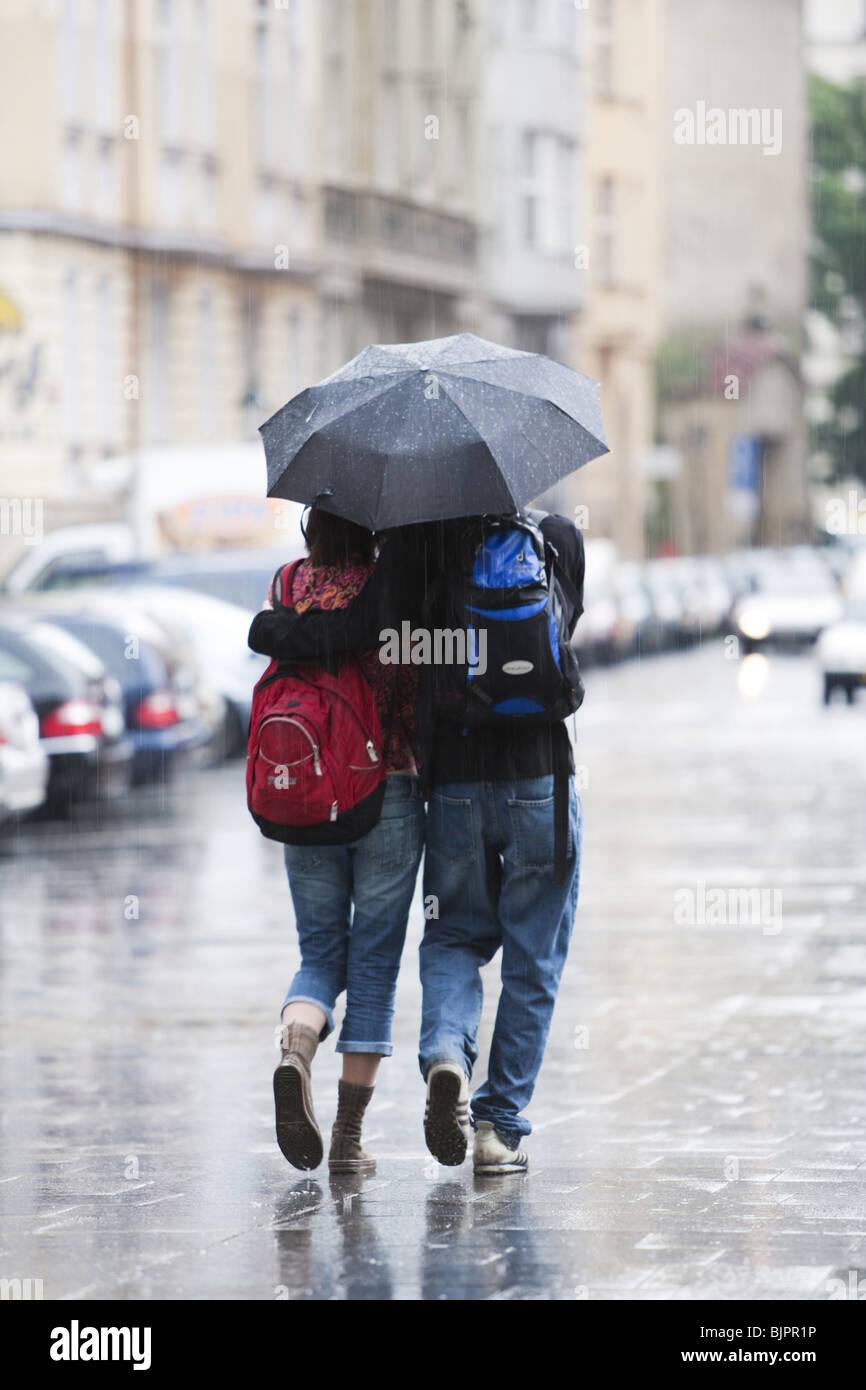 couple with umbrella in the rain stock photo 28775202 alamy