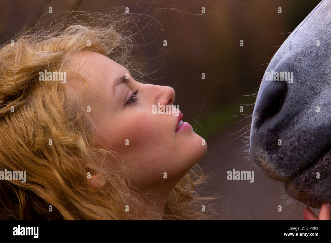 Girl with horse 4 - Stock Image