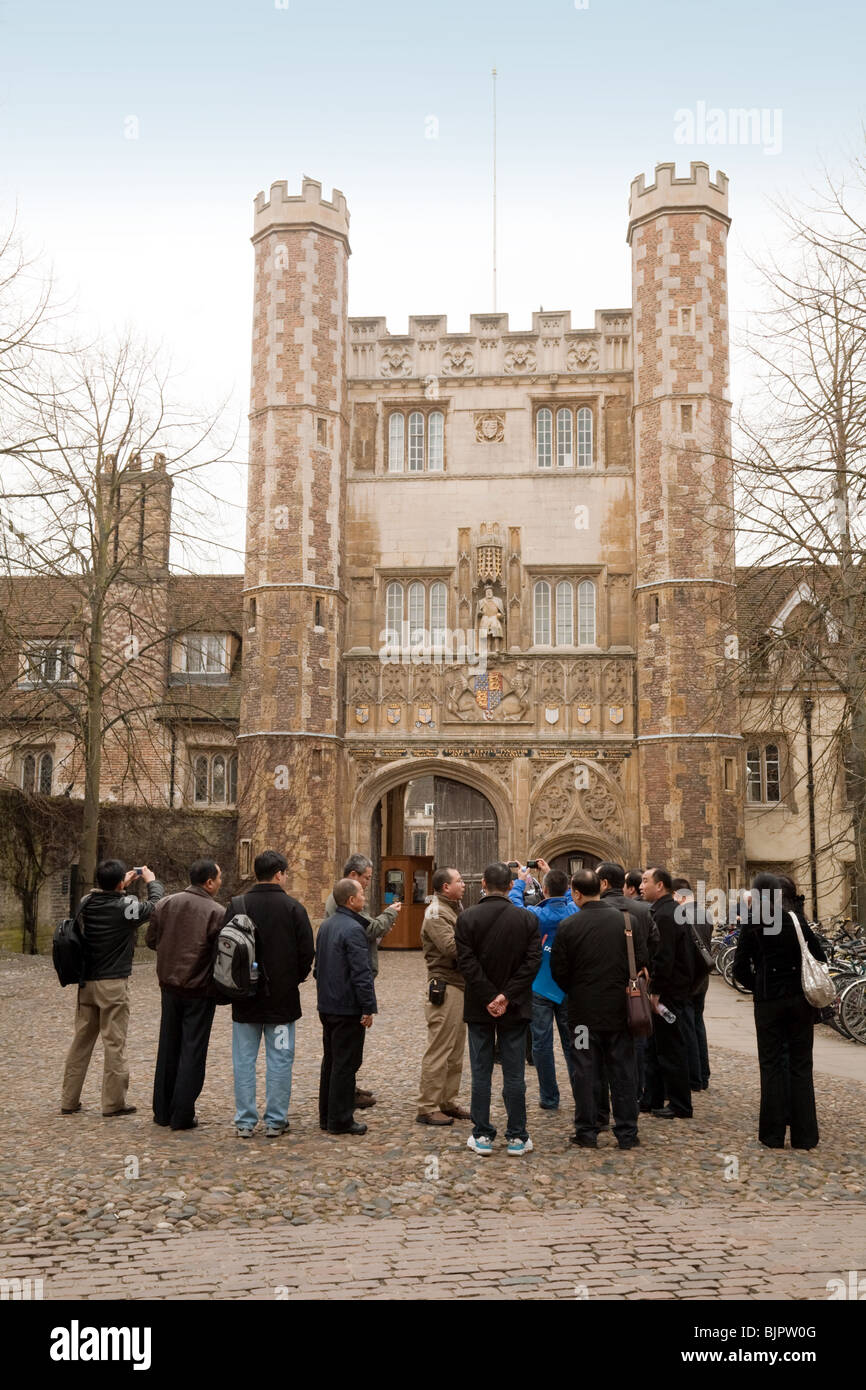 Tourists at the main entrance to Trinity College, on Trinity Street, Cambridge University, UK - Stock Image