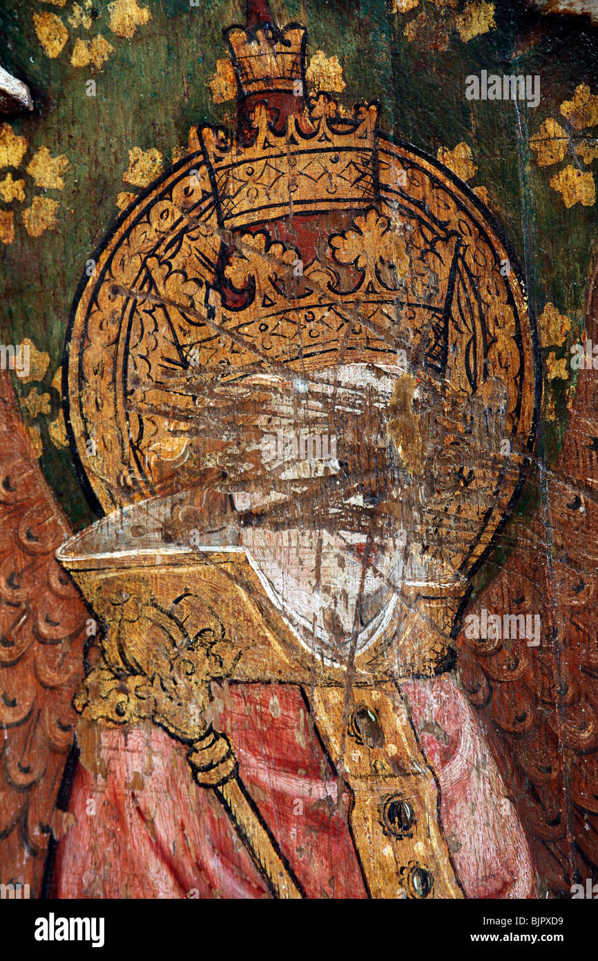 Rood Screen depicting a Dominion Angel, defaced during the Reformation, St Michael and All Angels Church, Barton - Stock Image