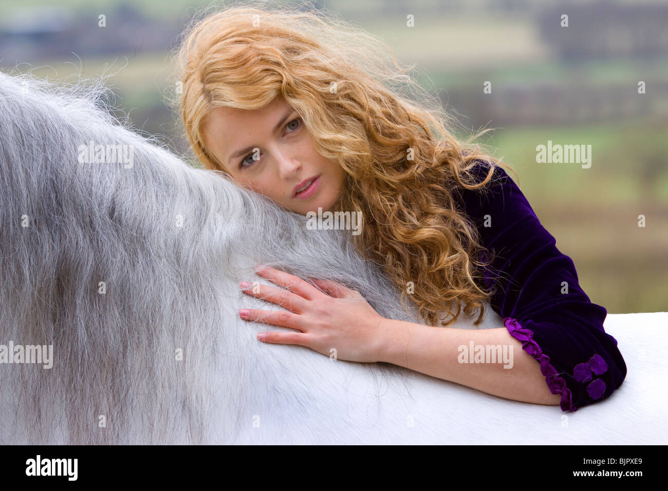 Girl with horse 1 - Stock Image