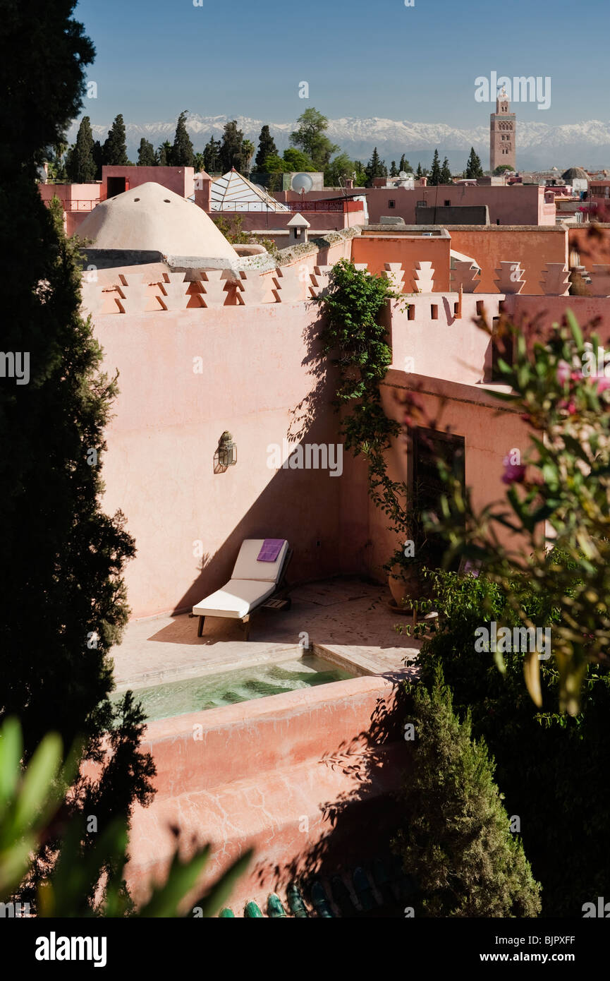 View on to a roof terrace in the Medina of Marrakesh with Atlas mountains in the distance - Stock Image