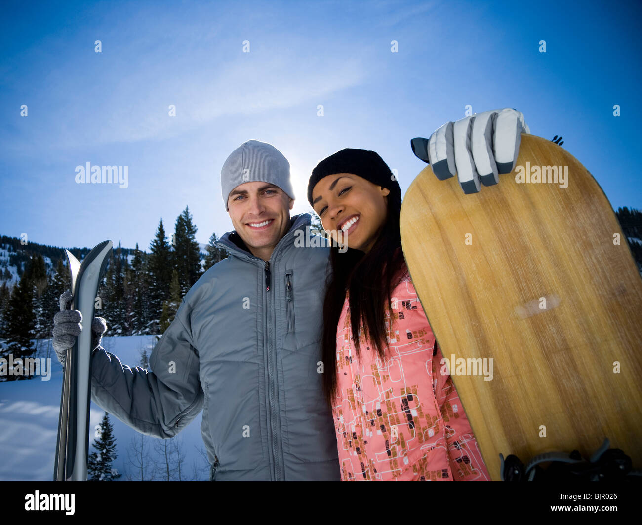A couple outside in the snow - Stock Image