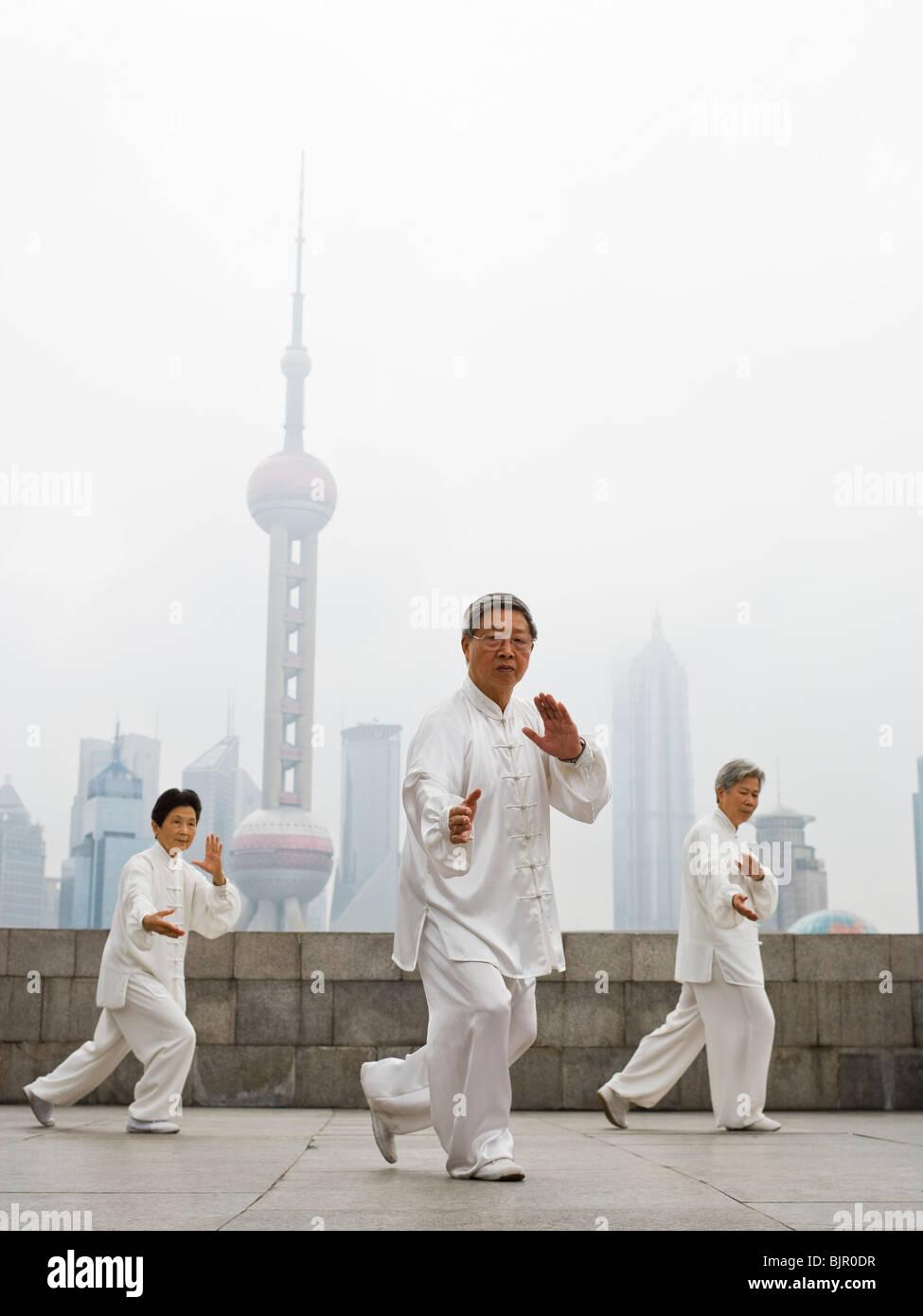 senior practicing tai chi. - Stock Image