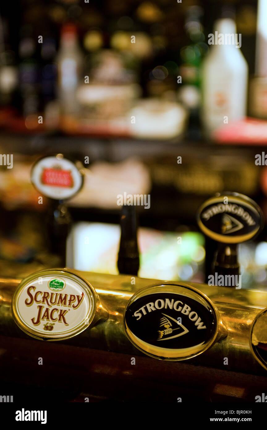 Cider pumps in a pub. - Stock Image