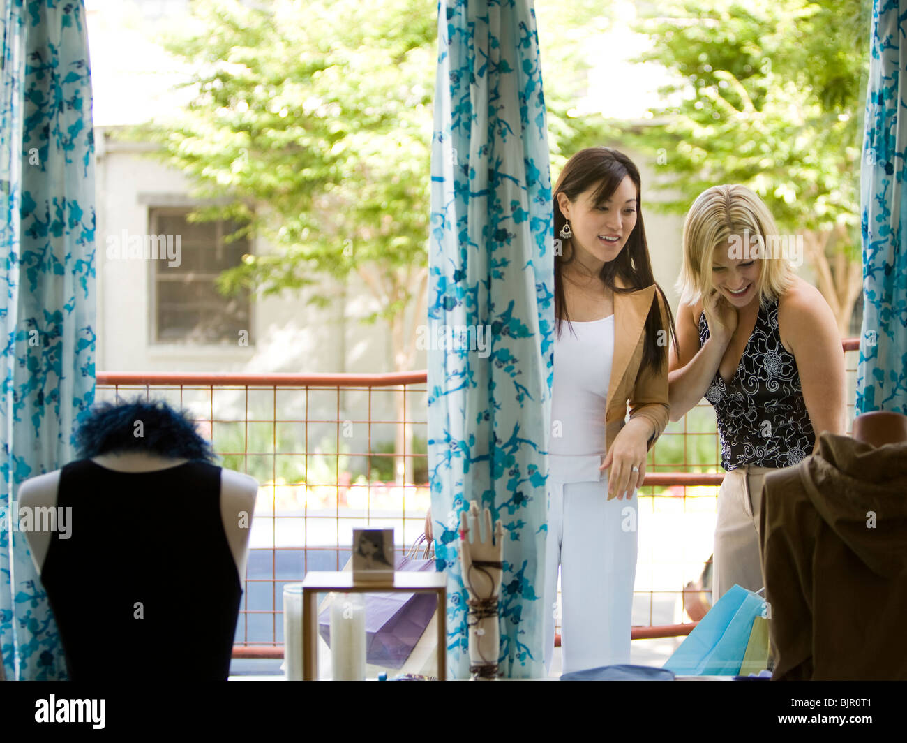 Two girl friends shopping - Stock Image