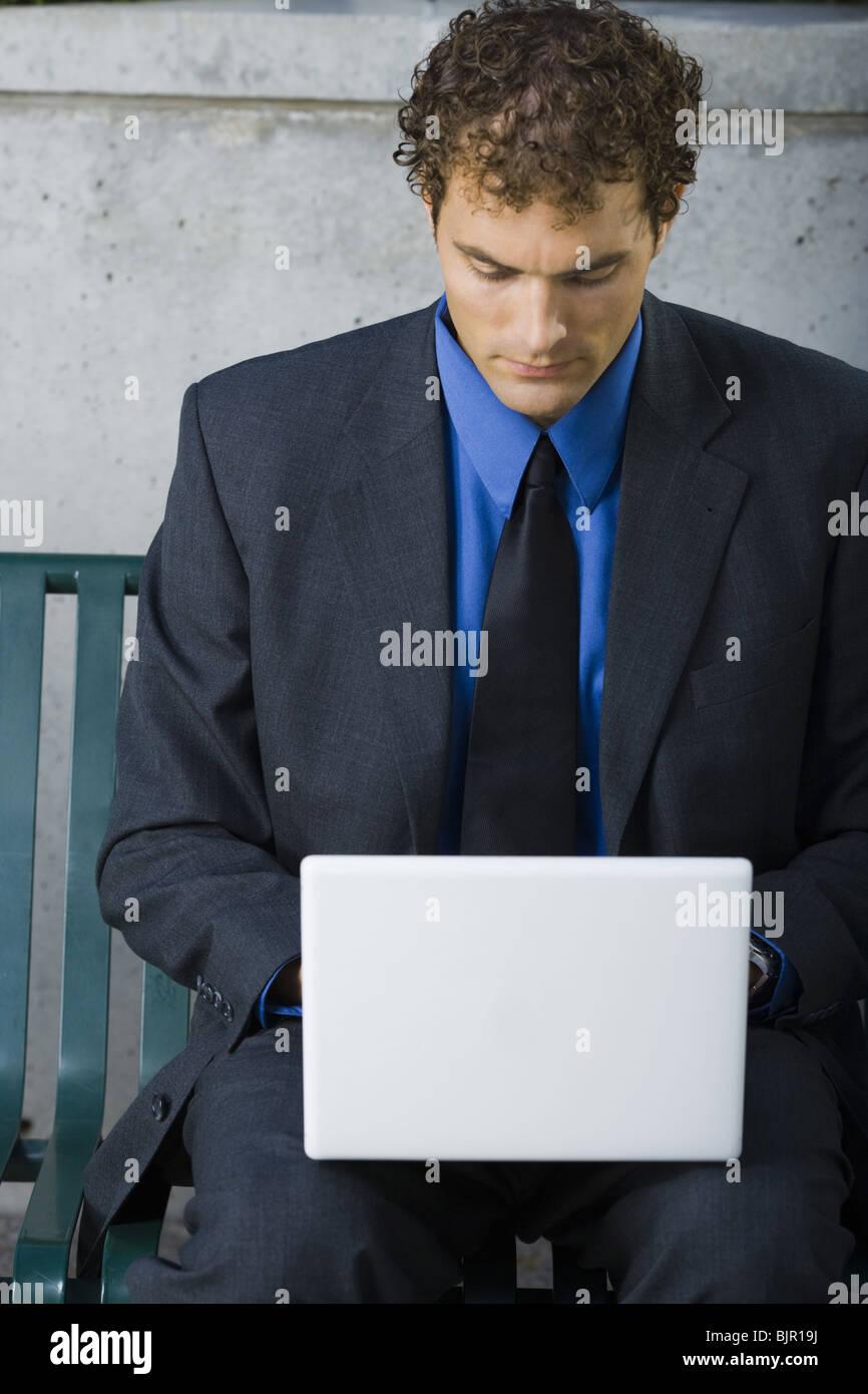 Man on laptop - Stock Image