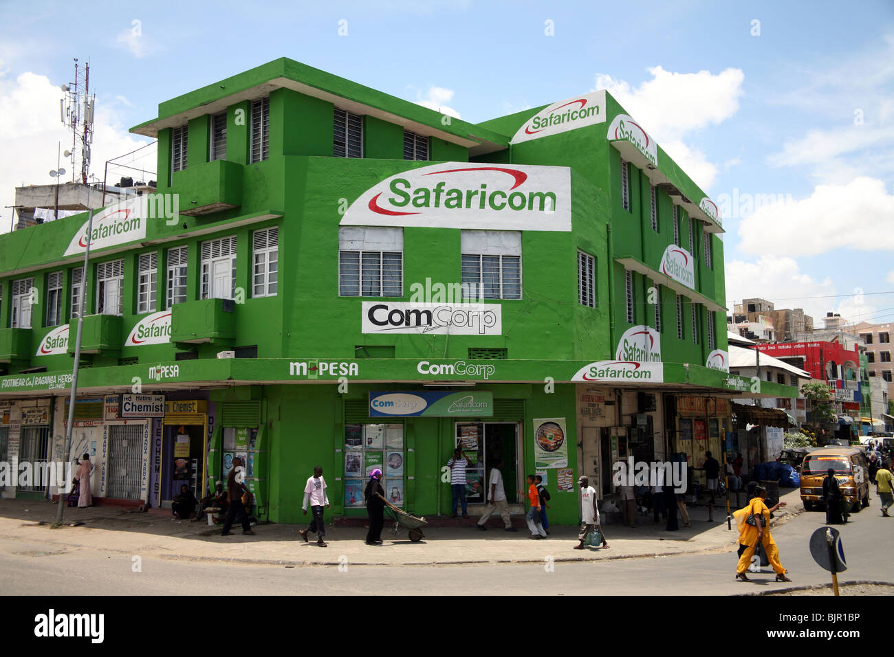Street scene with shop painted in Safaricom old town Mombasa Island Stock Photo