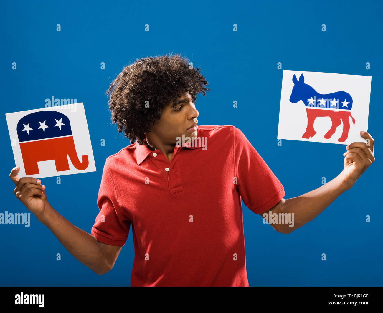 young man choosing between political parties. - Stock Image