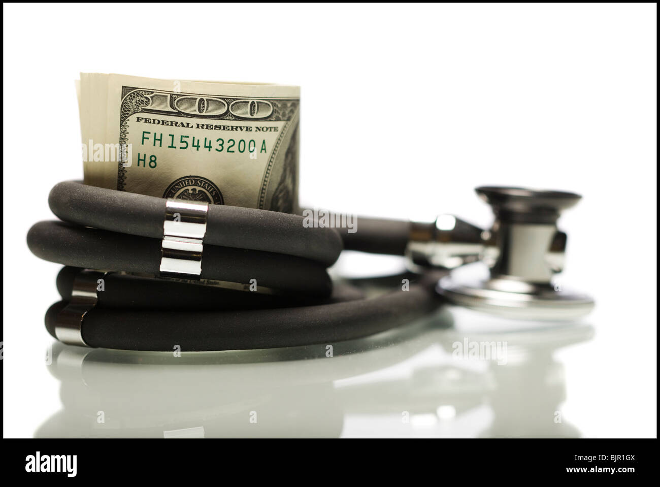 Money wrapped in a stethoscope. - Stock Image