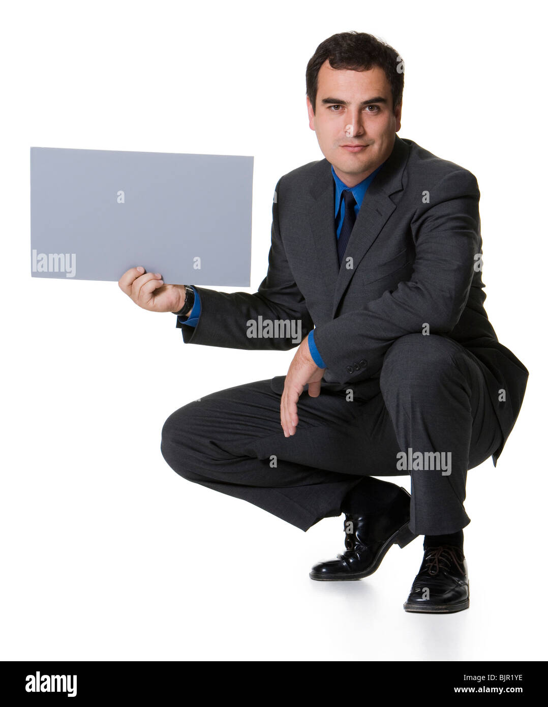 Businessman with blank sign - Stock Image