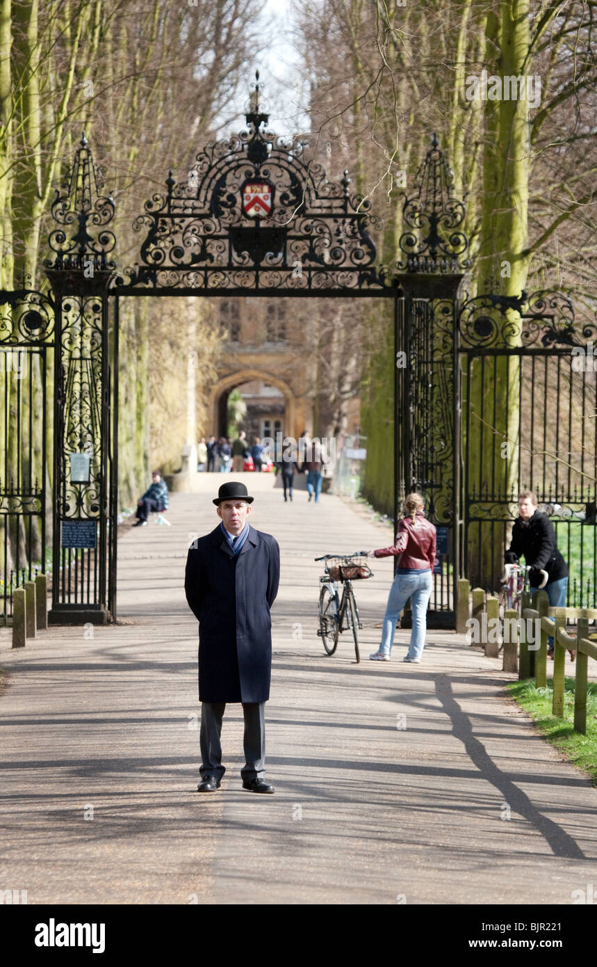 A porter at the back entrance to Trinity College, Cambridge University, UK - Stock Image