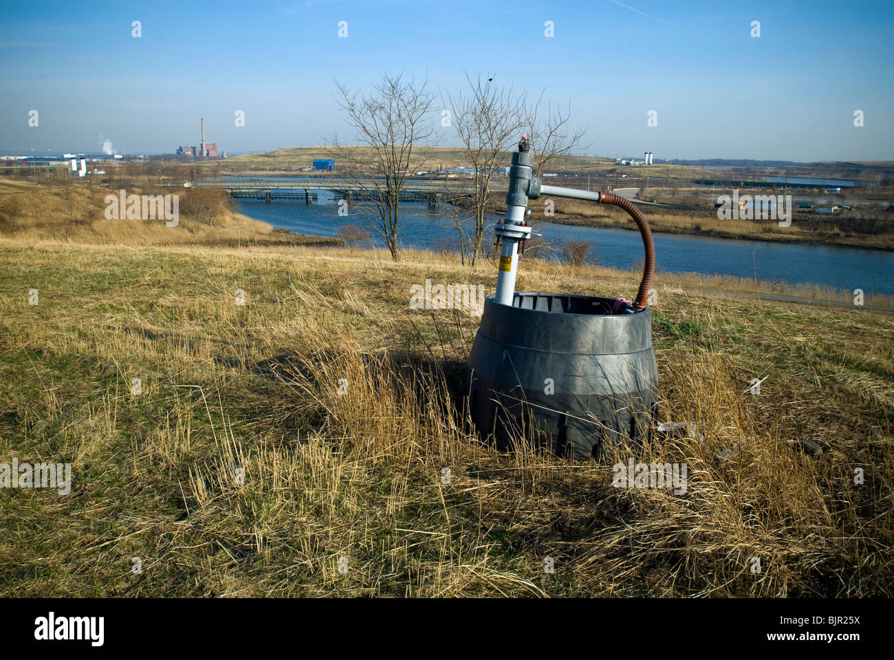An active methane gas collection wellhead seen on South Mound in the Fresh Kills landfill in Staten Island in New - Stock Image