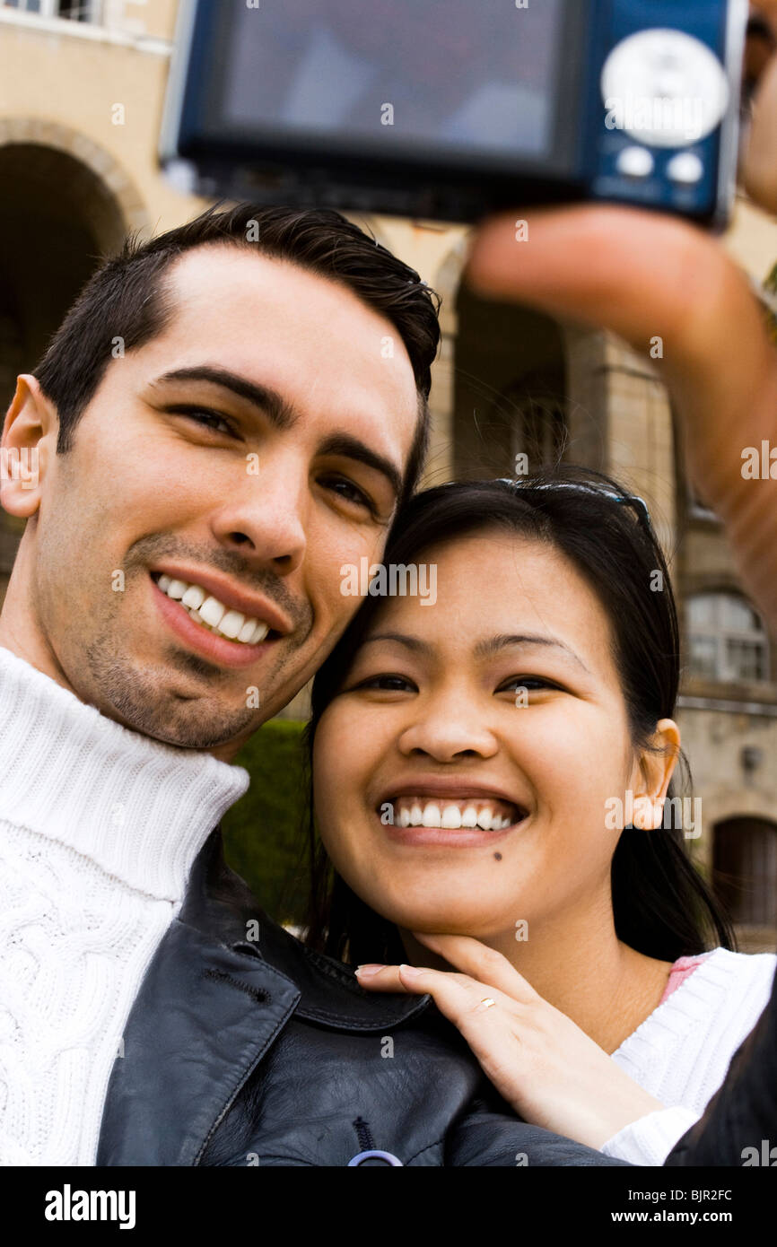 Couple using a digital camera Stock Photo