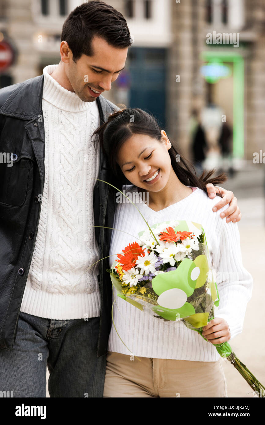 Couple on the street embracing Stock Photo