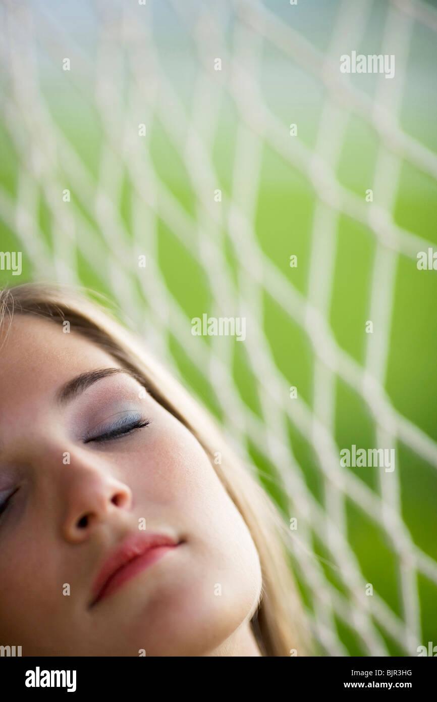 Teenage girl sleeping - Stock Image