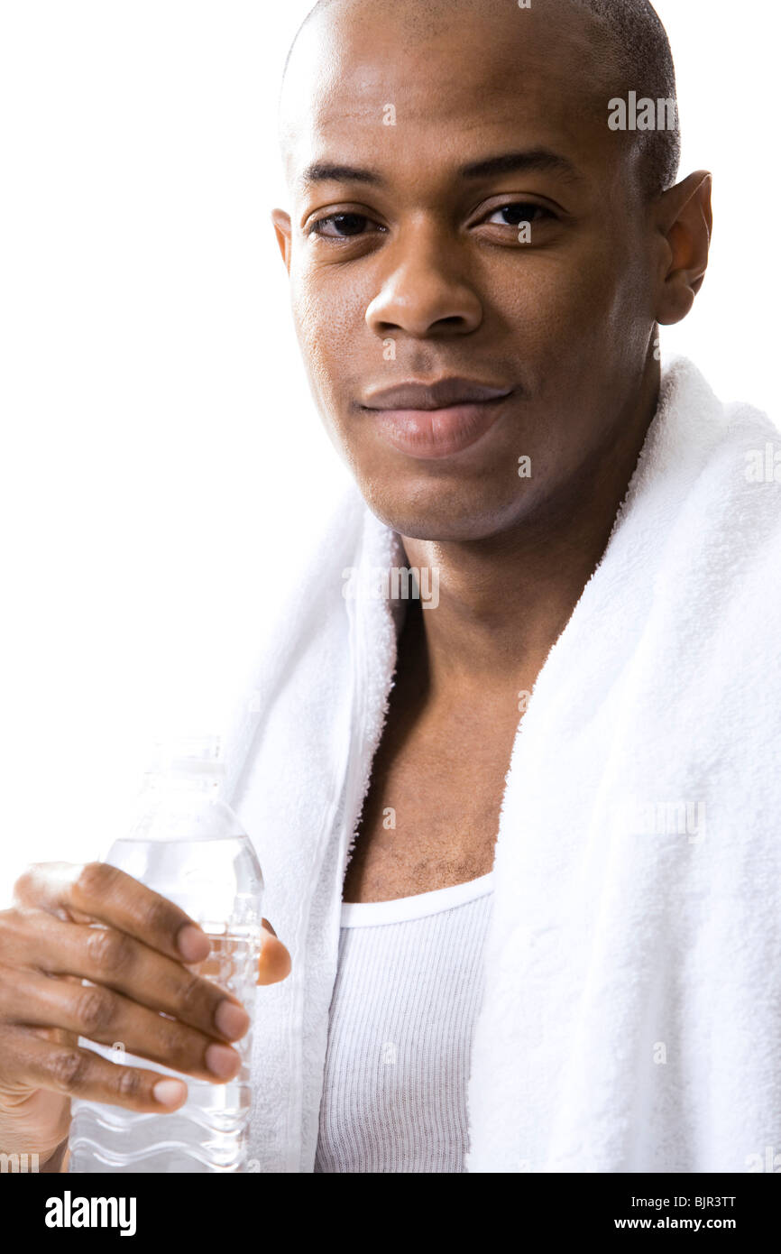 Man with white towel around his neck - Stock Image