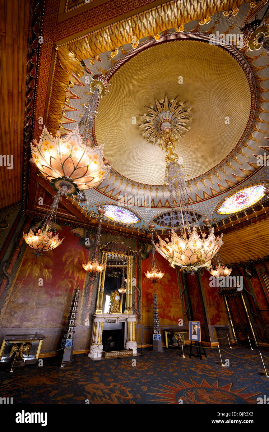 The ornate chandeliers and fireplace of the music room in the royal the ornate chandeliers and fireplace of the music room in the royal pavilion brighton east sussex uk aloadofball Gallery