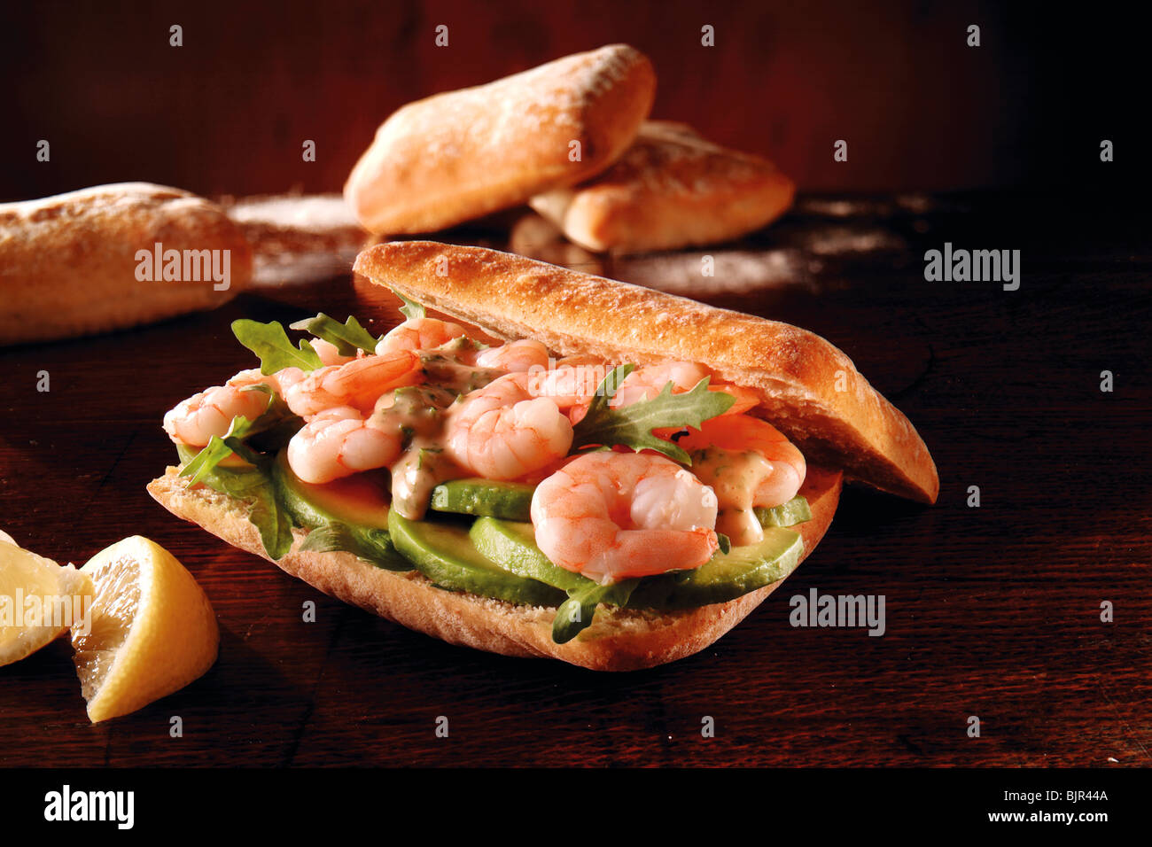 Prawn, avacado and rocket chiabatta sandwich. Food photos. - Stock Image