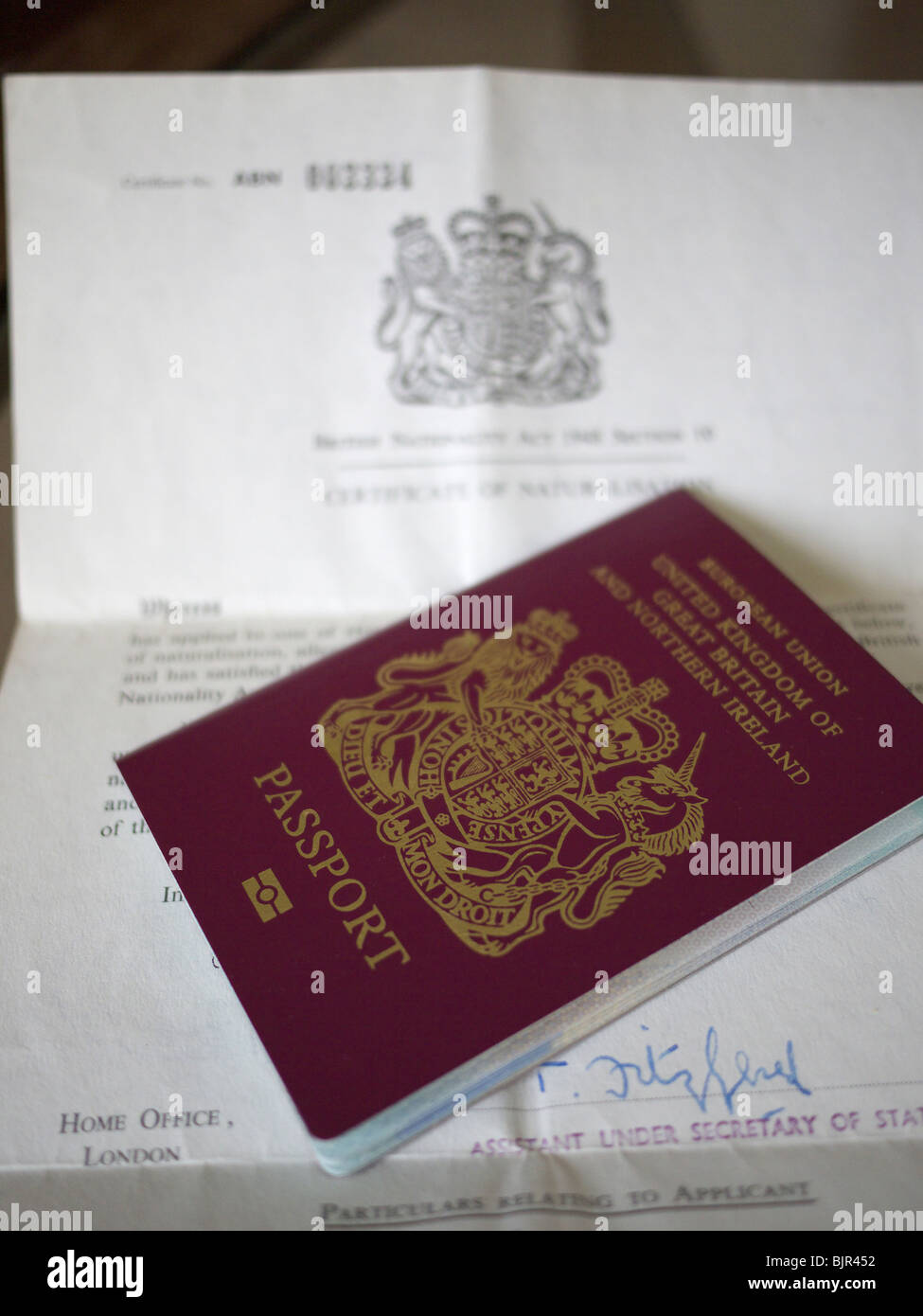 UK Certificate of Naturalization with UK passport. - Stock Image