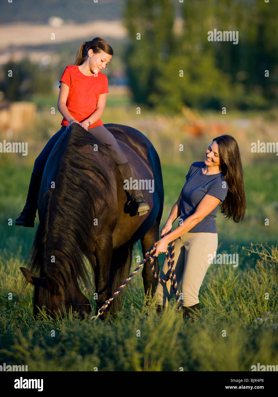 Mother And Daughter With A Horse Stock Photo Alamy