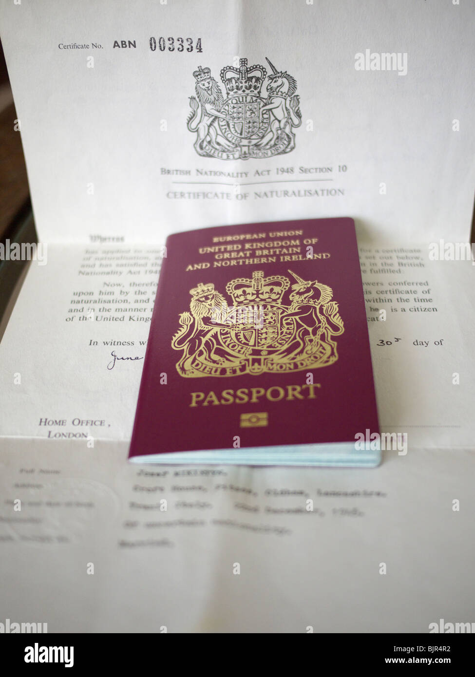 Passport with certificate of Naturalization. England UK. - Stock Image
