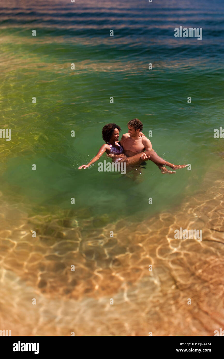 Couple together in the water Stock Photo