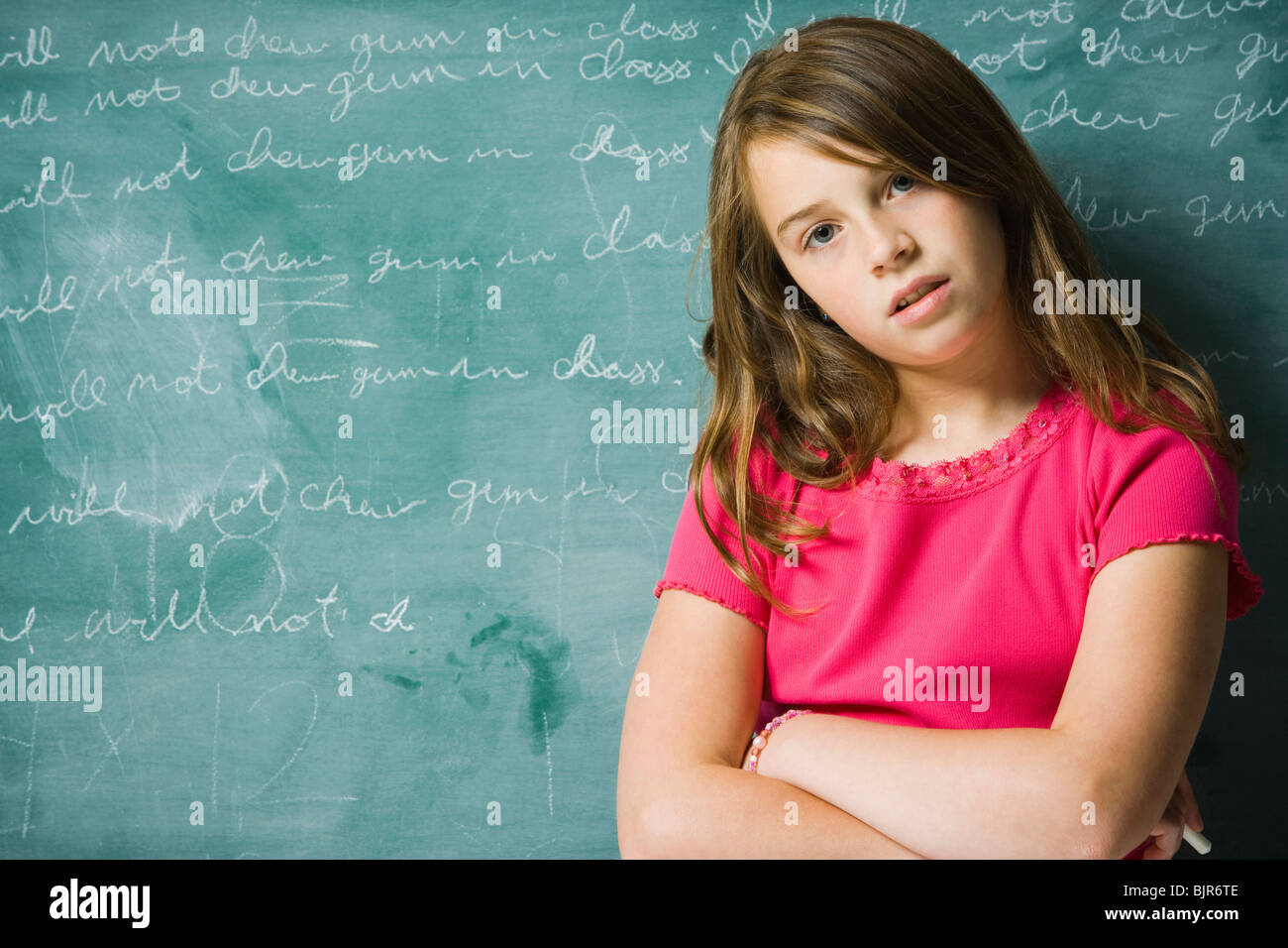 Sad girl in classroom - Stock Image