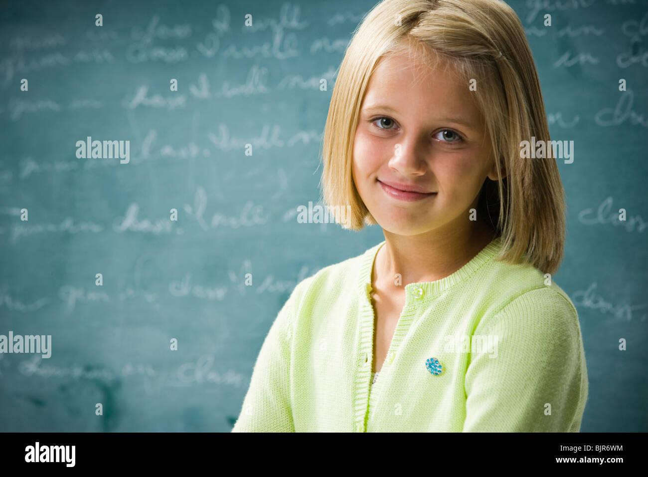 Girl in classroom - Stock Image