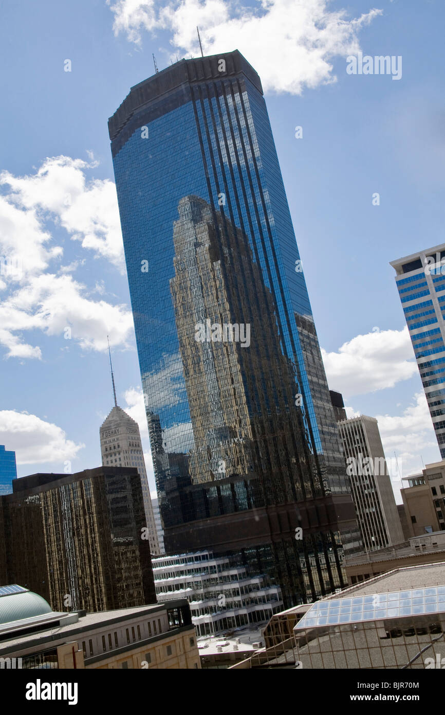 The Wells Fargo tower reflected in the IDS tower in Minneapolis, Minnesota. - Stock Image