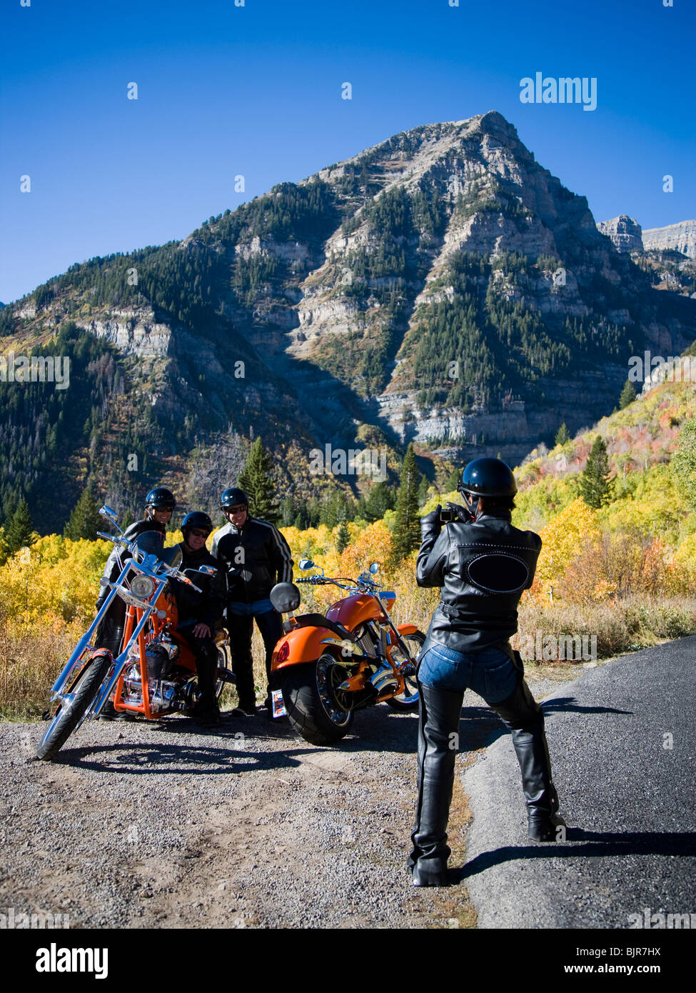 bikers taking a photo on the side of the road - Stock Image