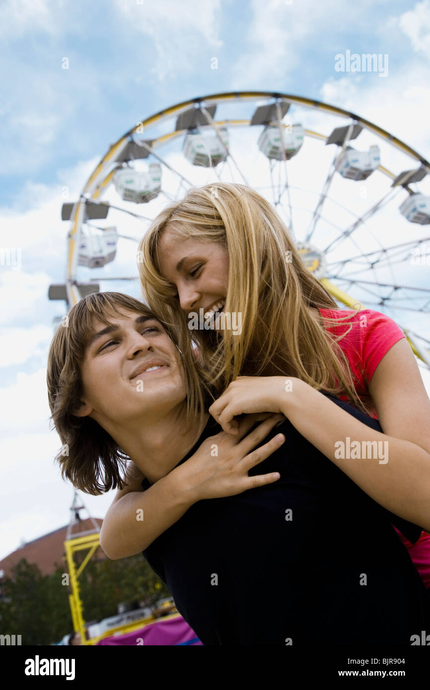 young couple at an amusement park Stock Photo