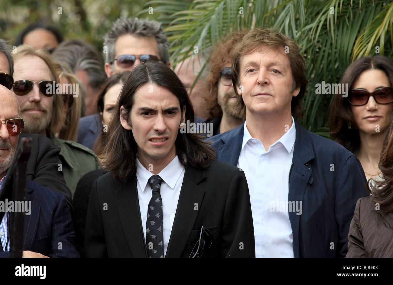 TOM PETTY DHANI HARRISON PAUL MCCARTNEY NANCY SHEVELL GEORGE HONORED POSTHUMOUSLY WITH A STAR ON THE HOLLYWOOD WALK