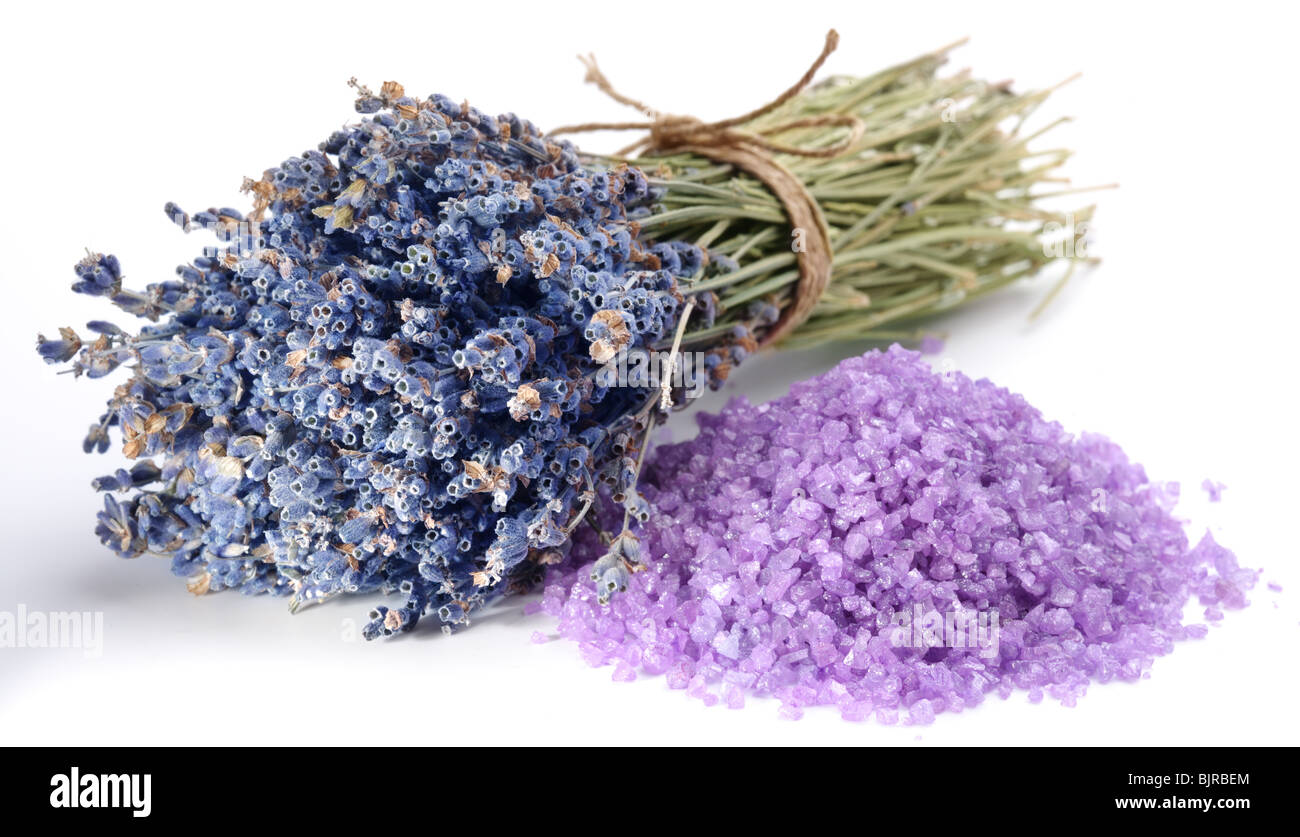 handful of sea salt flavored with dried lavender flowers. - Stock Image