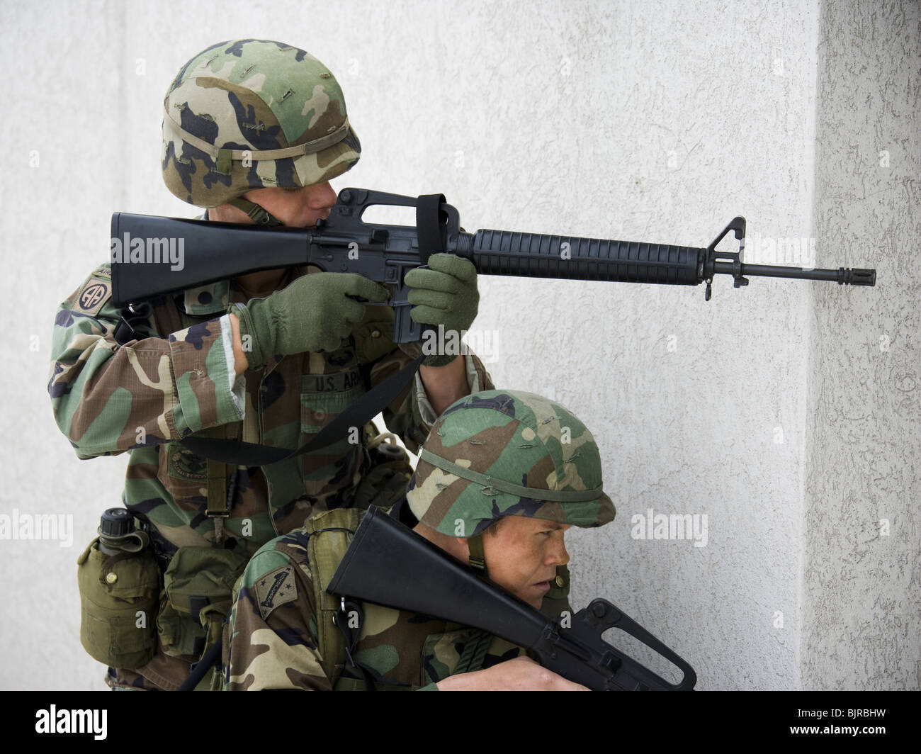 Soldiers aiming weapons - Stock Image