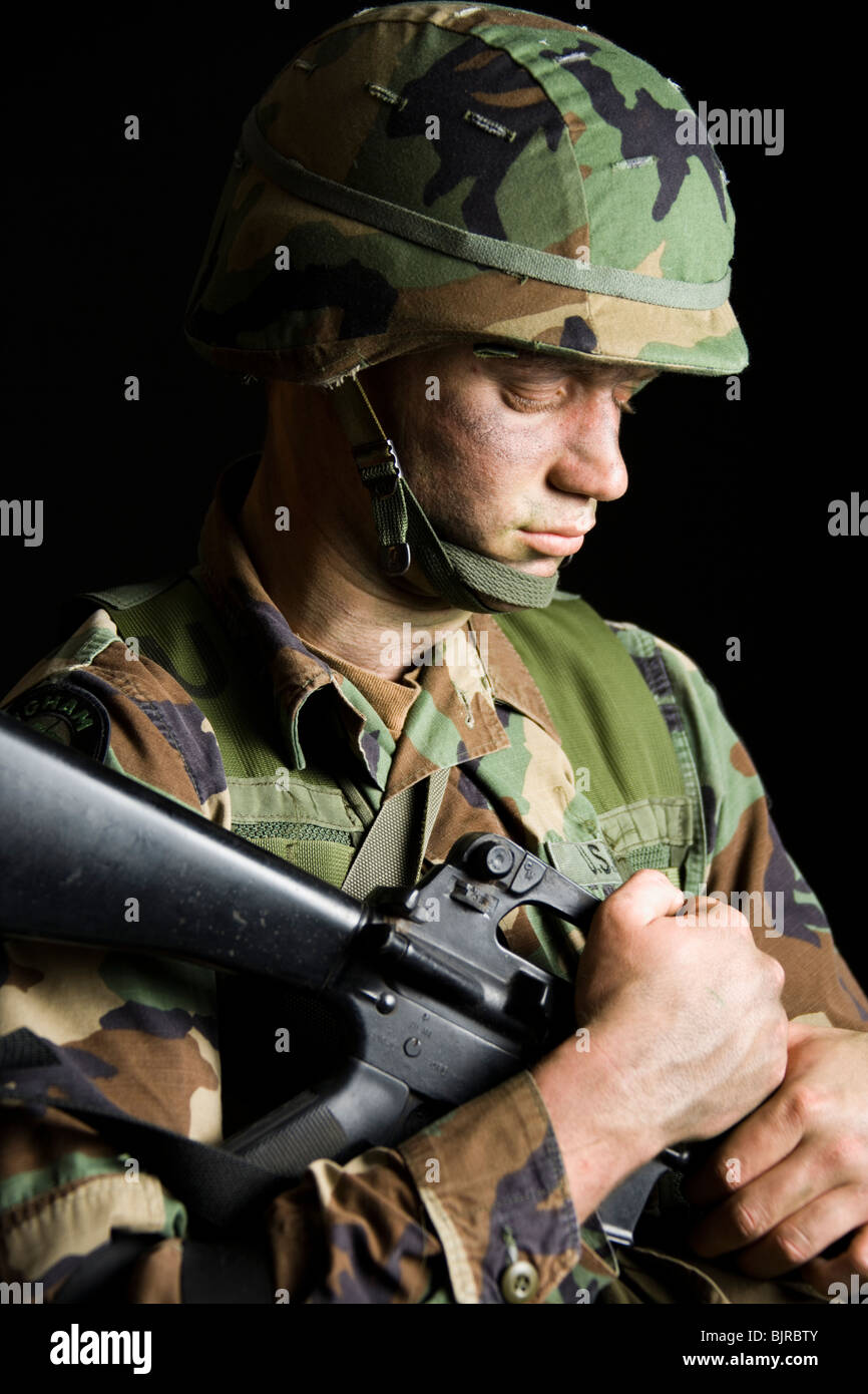 Soldier with Camouflage Face - Stock Image