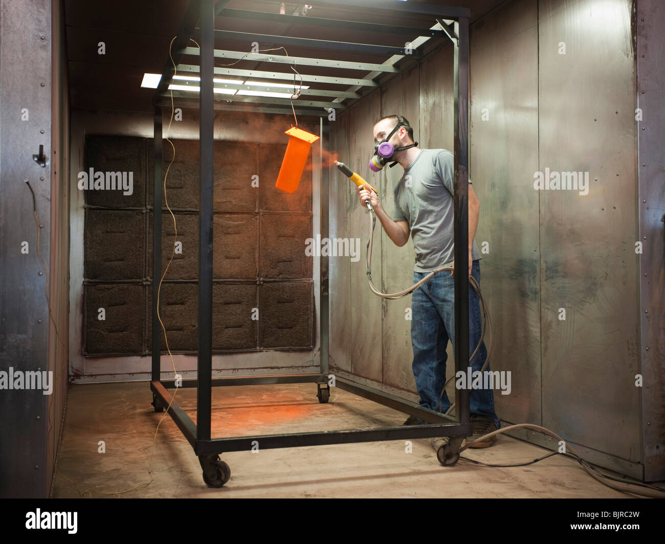 USA, Utah, Orem, man using paint spray gun - Stock Image