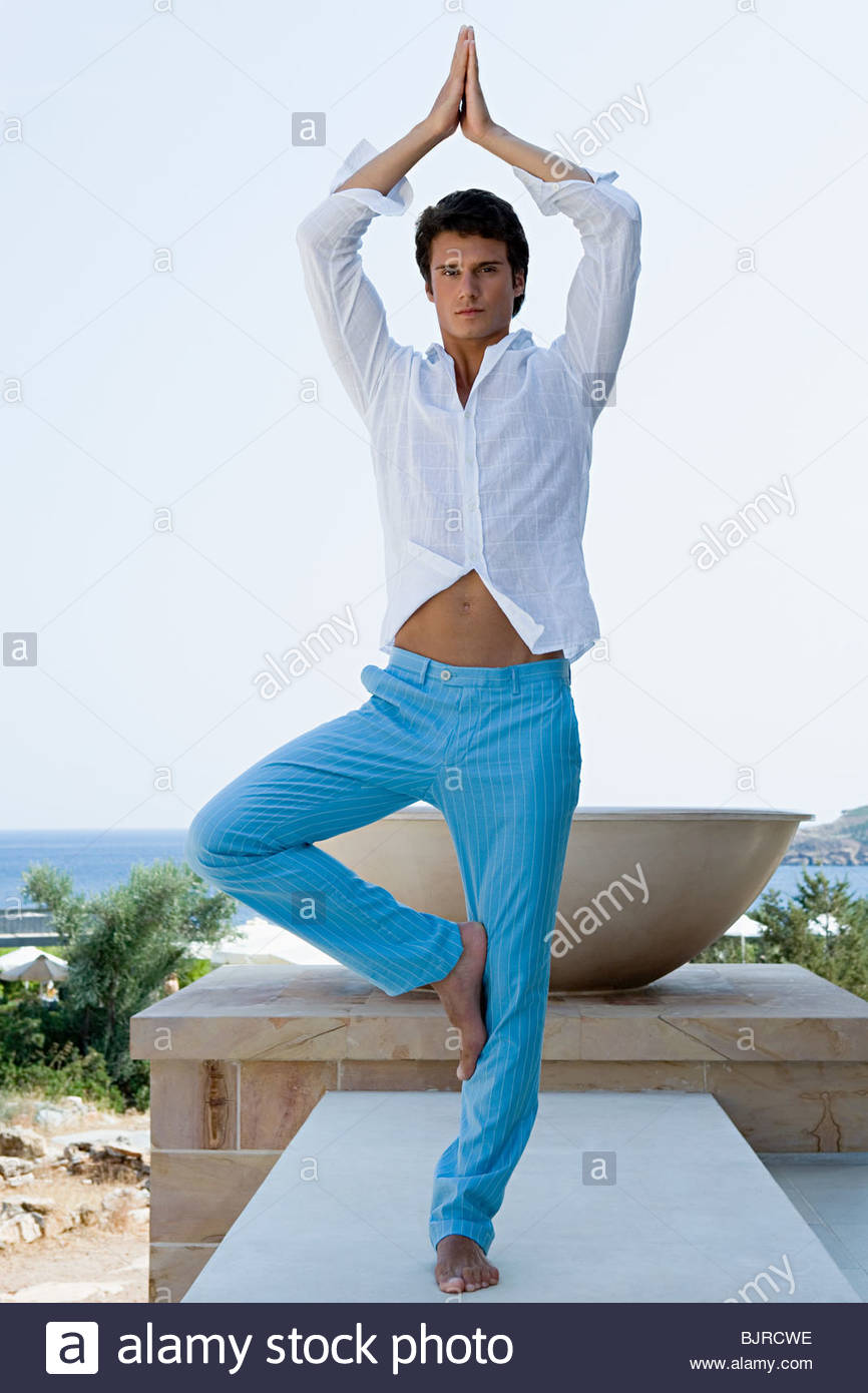 Man in yoga pose - Stock Image