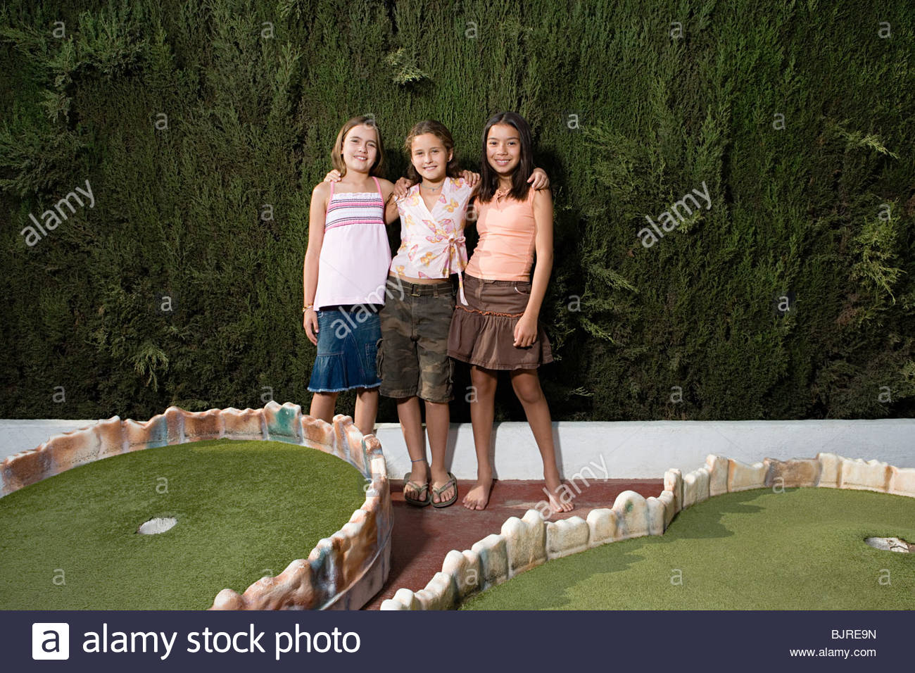 Girls at a miniature golf course - Stock Image