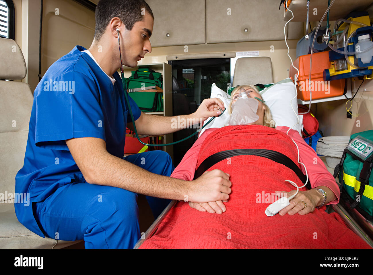 Nurse and patient in ambulance Stock Photo