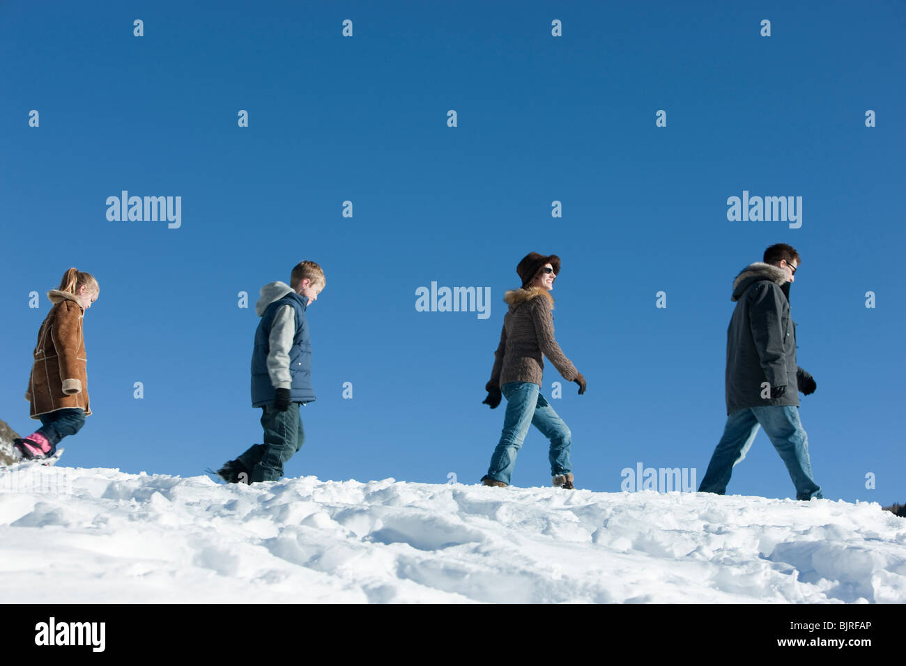 USA, Utah, Big Cottonwood Canyon, family walking in snow Stock Photo
