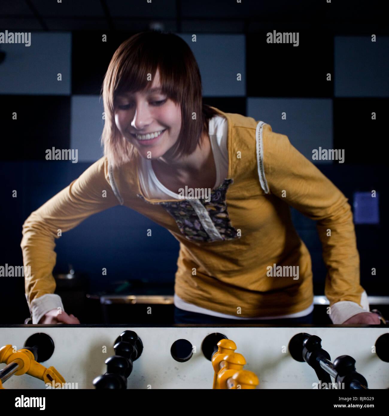 USA, Utah, American Fork, young woman playing table football - Stock Image