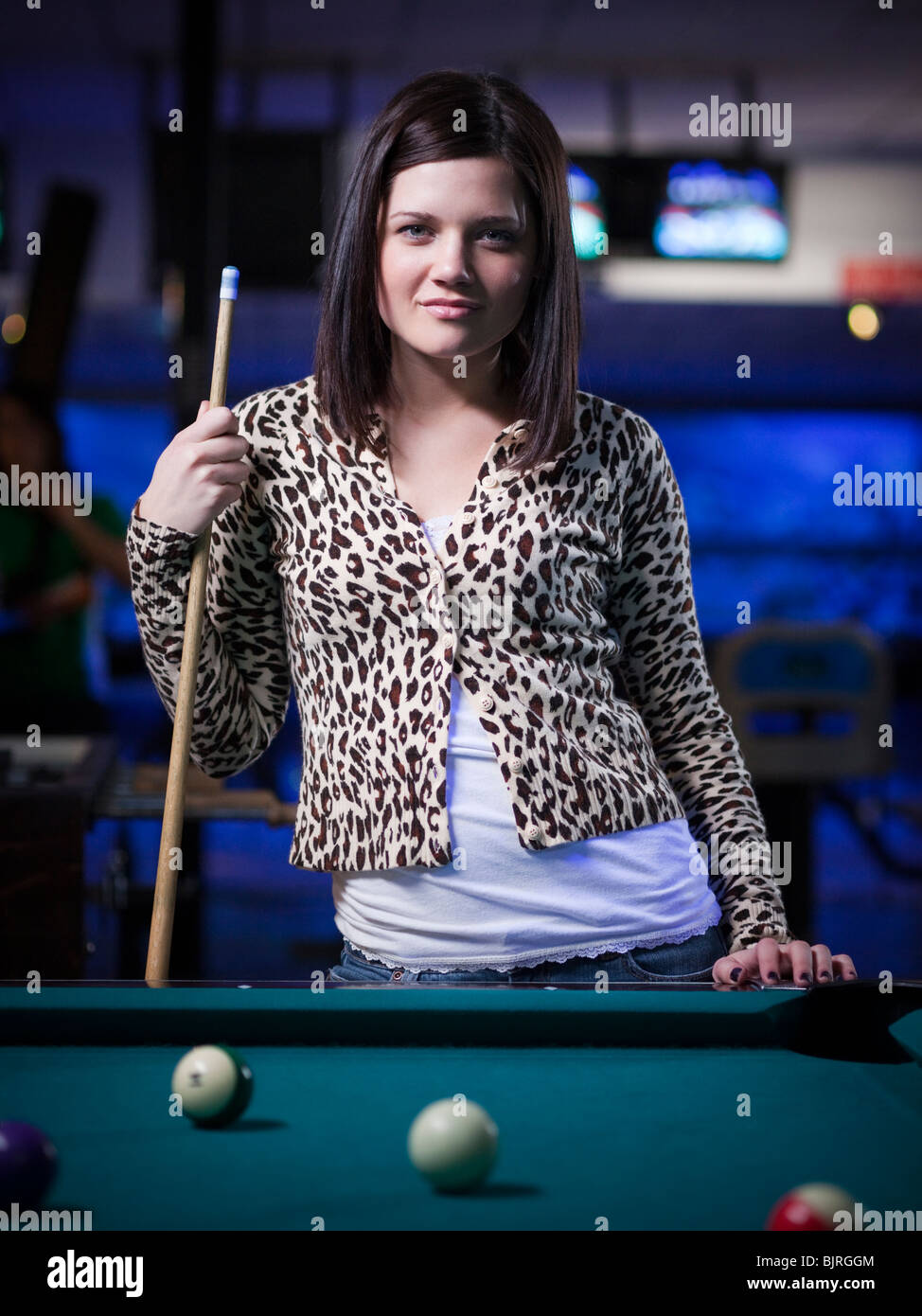 USA, Utah, American Fork, young woman standing behind pool table Stock Photo