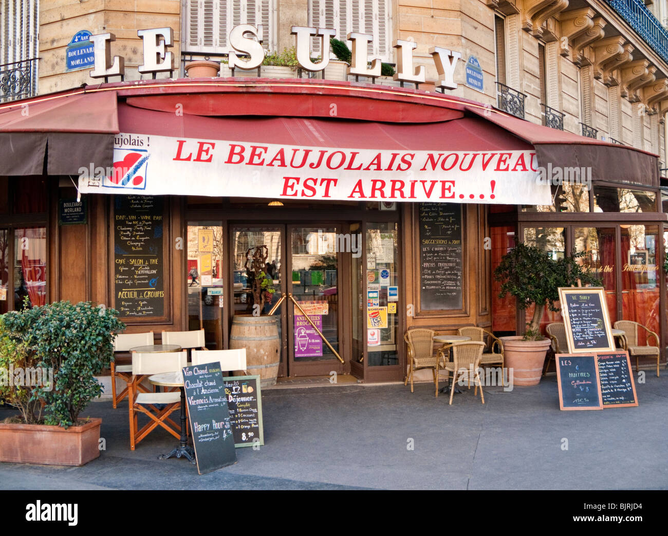 Restaurant with banner proudly announcing the arrival of Beaujolais Nouveau in Paris, France, Europe - Stock Image