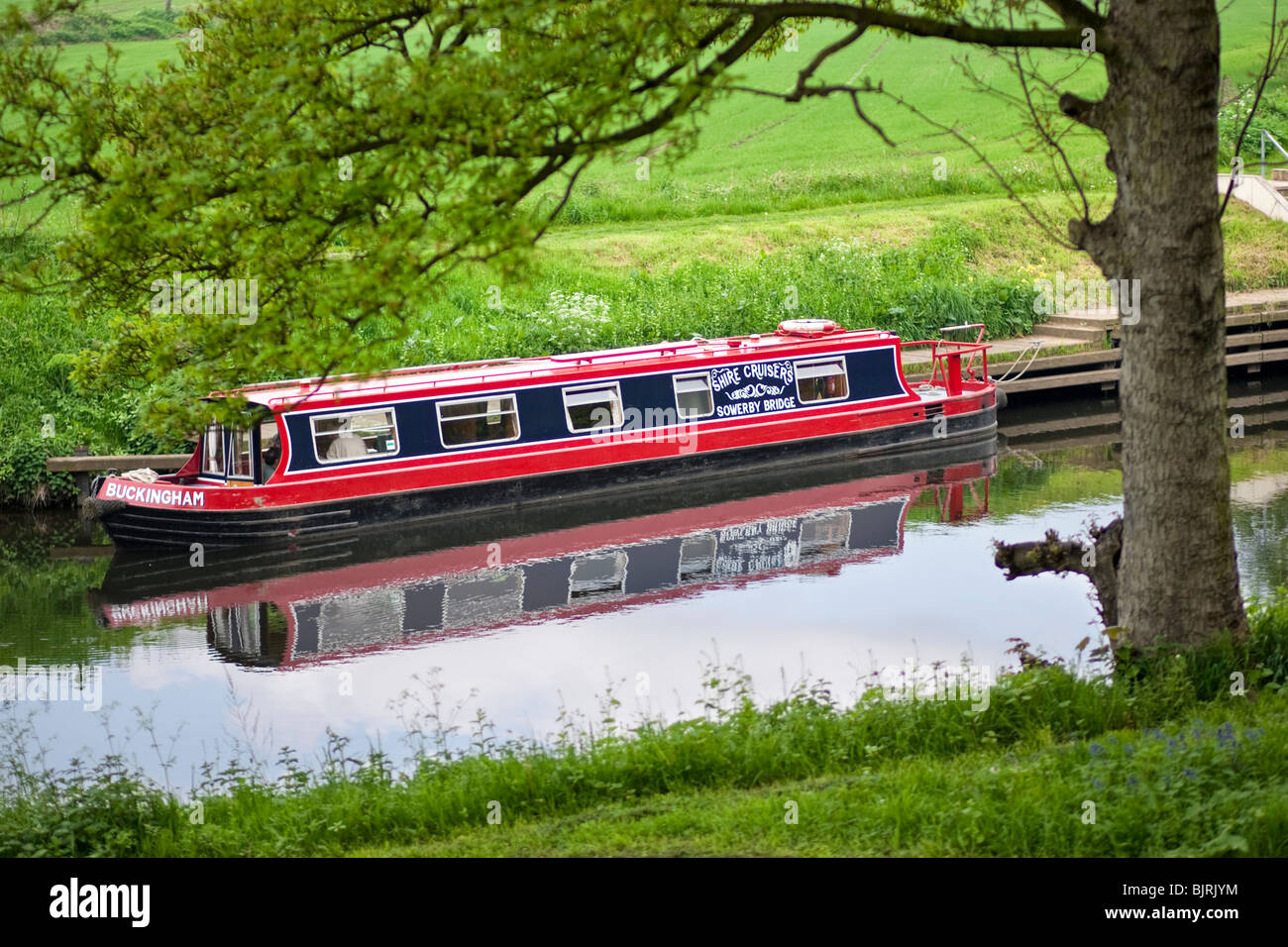 Canal boat uk - barge docked outside a lock on the Huddersfield Narrow Canal, near Huddersfield, West Yorkshire, - Stock Image