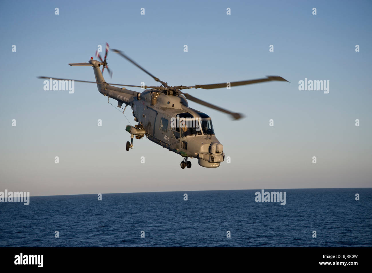 Royal Navy Mk8 Lynx helicopter in flight at sea - Stock Image