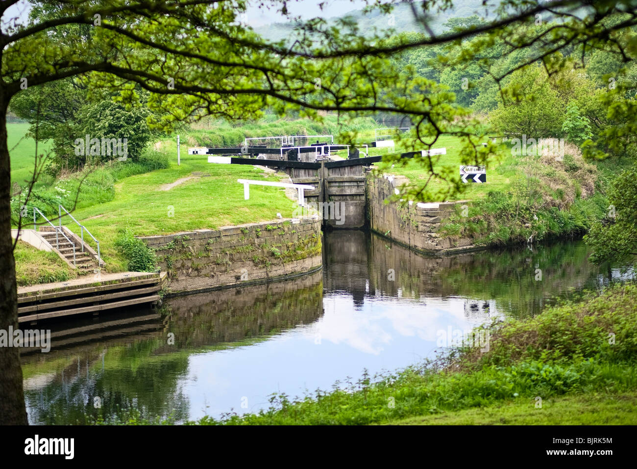 Canal lock on the Huddersfield Canal, West Yorkshire, England, UK - Stock Image