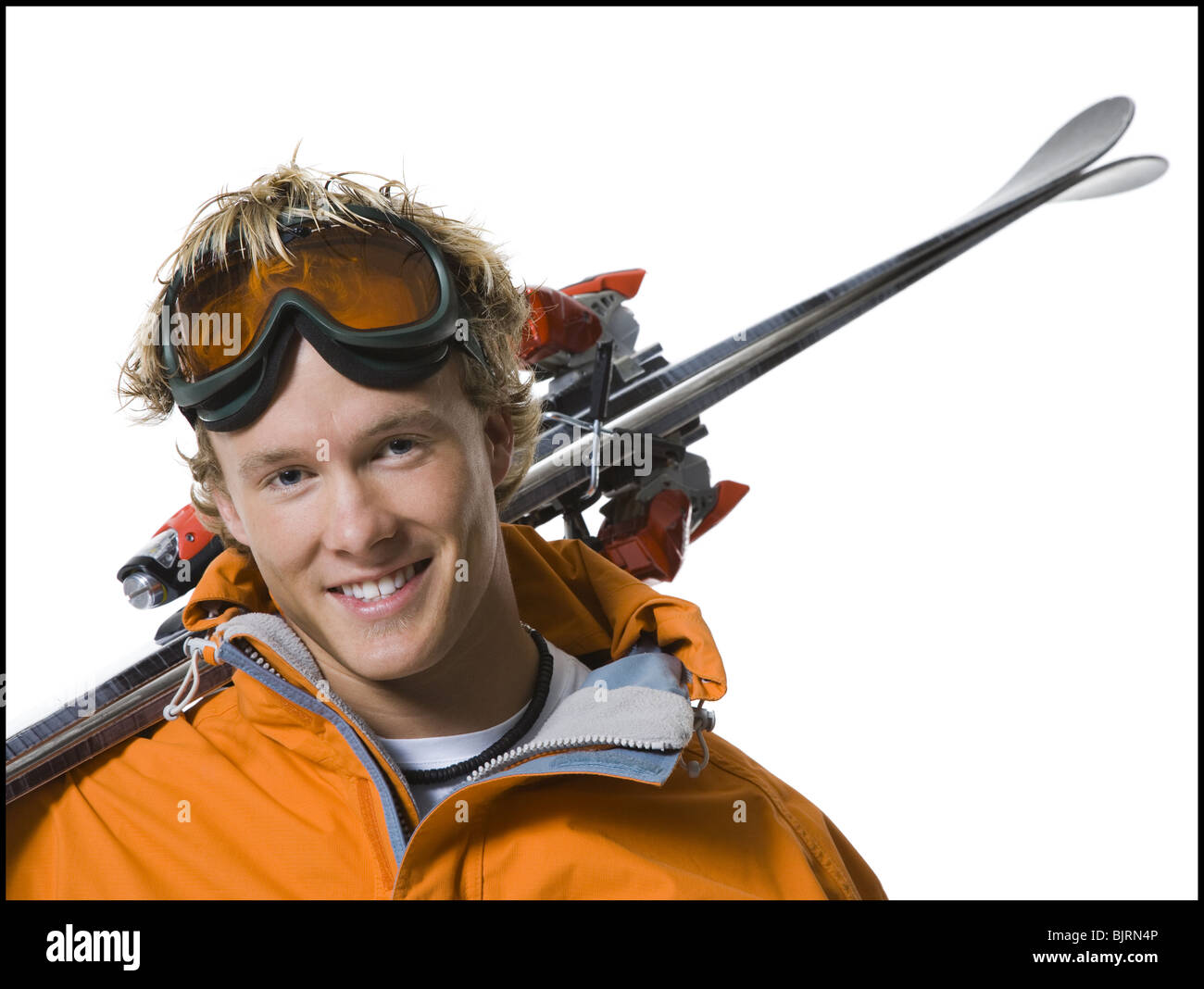 Male skier in orange ski jacket Stock Photo