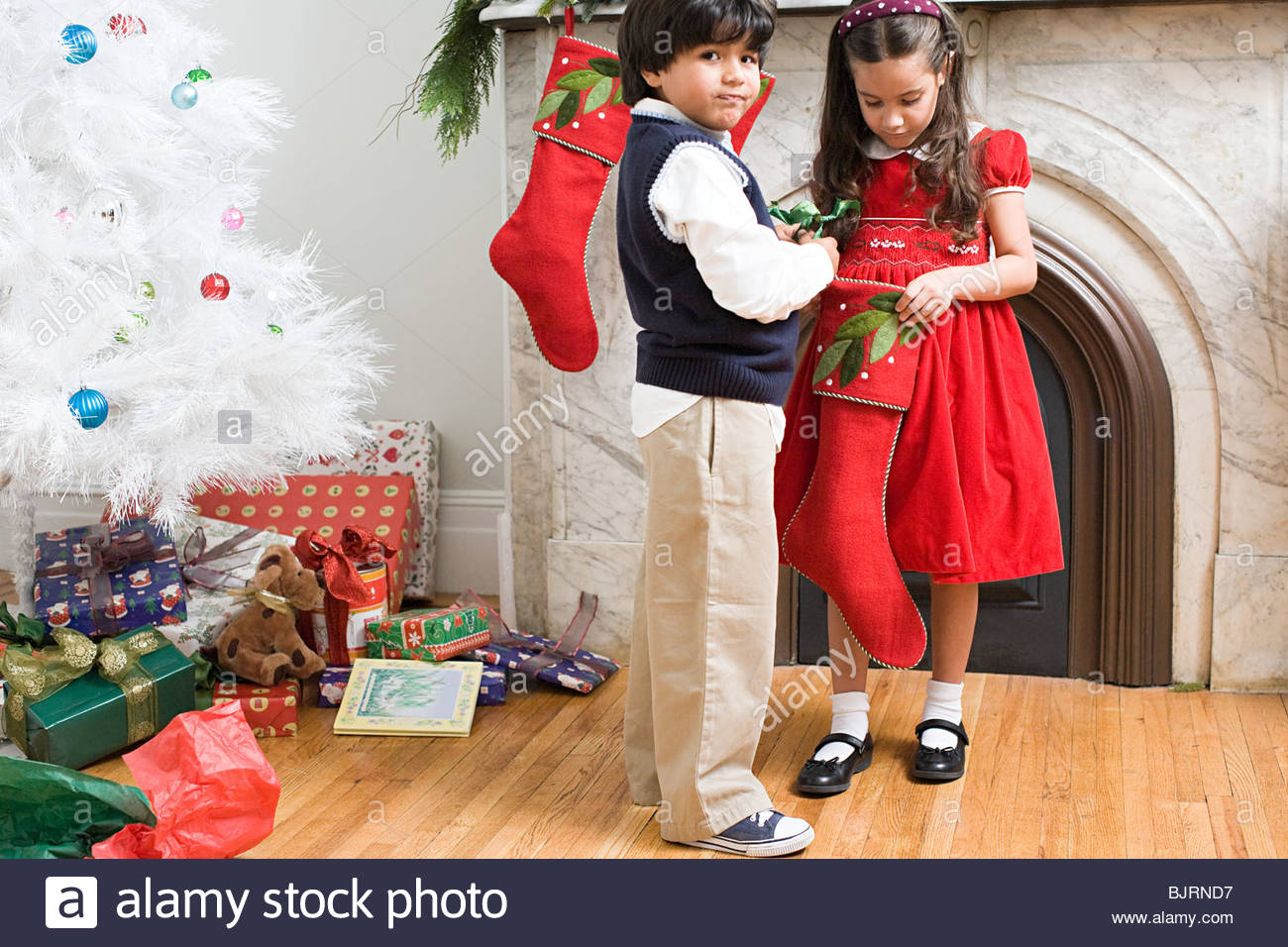 Children holding a stocking - Stock Image